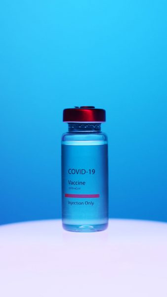 A picture of the COVID-19 vaccine, in a glass vial.